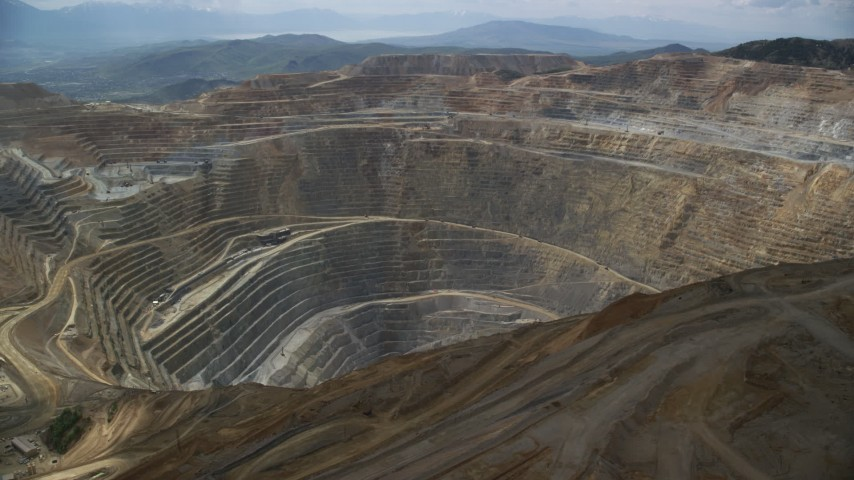 Orbiting Bingham Canyon Mine (Kennecott Copper Mine), Utah Aerial Stock Footage AX130_041