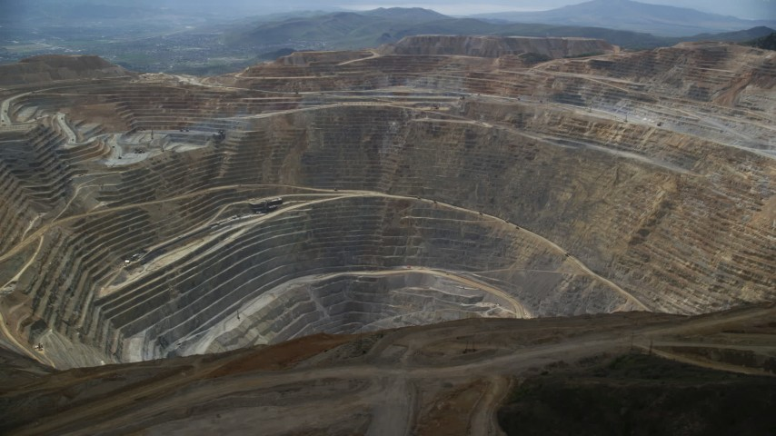 Orbiting Bingham Canyon Mine (Kennecott Copper Mine), Utah Aerial Stock Footage | AX130_042