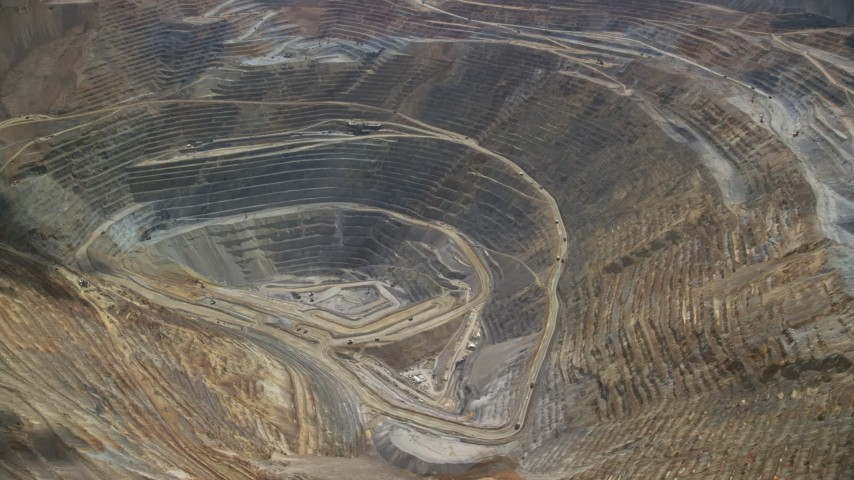 6K stock footage aerial video of orbiting gravel haulers, Kennecott Copper Mine, Bingham Canyon Mine, Utah Aerial Stock Footage AX130_044 | Axiom Images