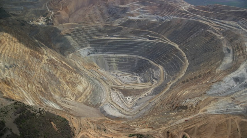 6K stock footage aerial video orbit of gravel haulers, Kennecott Copper Mine aka Bingham Canyon Mine, Utah Aerial Stock Footage | AX130_045