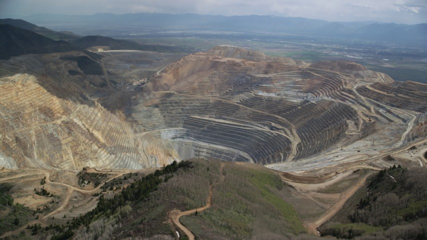 6K stock footage aerial video of circling around the Bingham Canyon Mine (Kennecott Copper Mine), Utah Aerial Stock Footage | AX130_048
