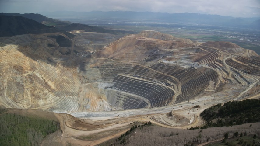 Orbiting the Bingham Canyon Mine (Kennecott Copper Mine), Utah Aerial Stock Footage | AX130_049
