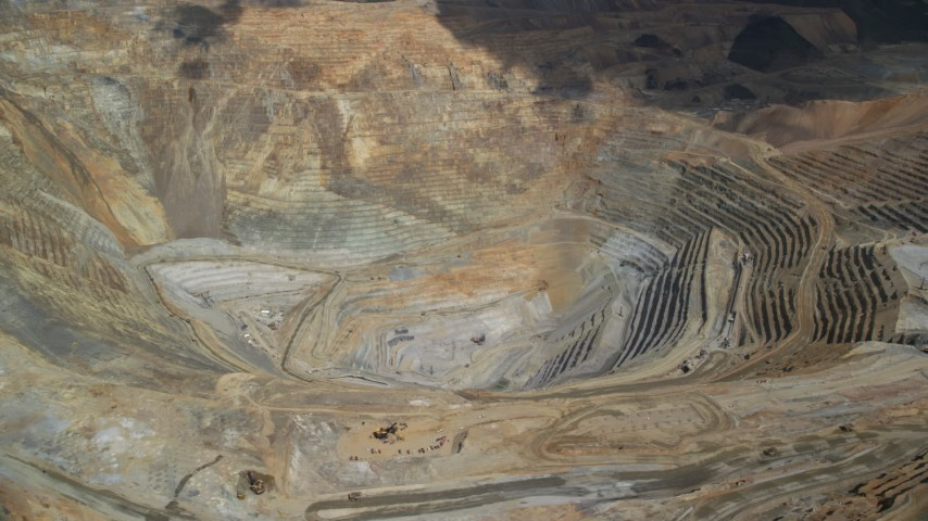 Orbiting Bingham Canyon Mine (Kennecott Copper Mine), Utah Aerial Stock Footage | AX130_052