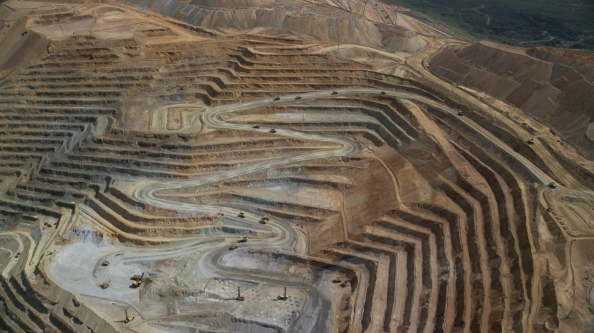 6K stock footage aerial video of flying away from gravel haulers, Bingham Canyon Mine, Utah Aerial Stock Footage | AX130_055