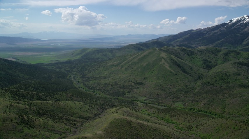 6K stock footage aerial video of approaching green ridges, Oquirrh Mountains, Utah Aerial Stock Footage | AX130_063