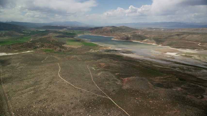 6K stock footage aerial video of approaching the Gunnison Reservoir with low water, Sanpete County, Utah Aerial Stock Footage | AX130_150