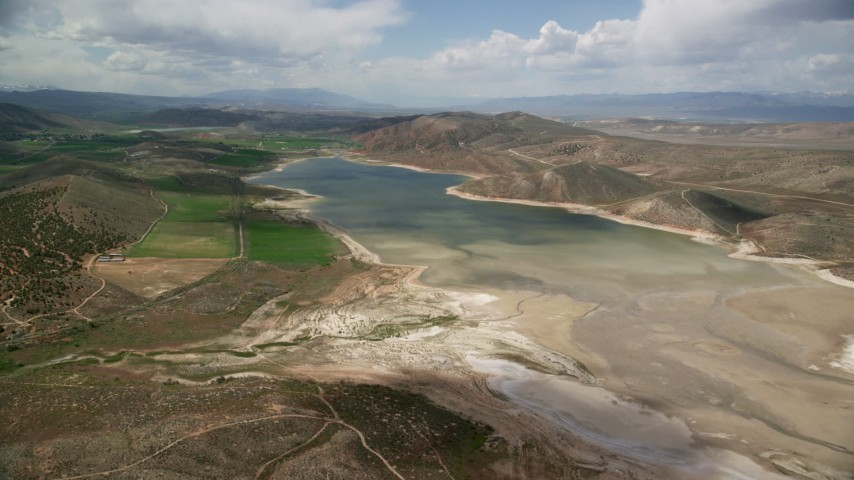 6K stock footage aerial video of flying toward Gunnison Reservoir with low water, Sanpete County, Utah Aerial Stock Footage | AX130_151