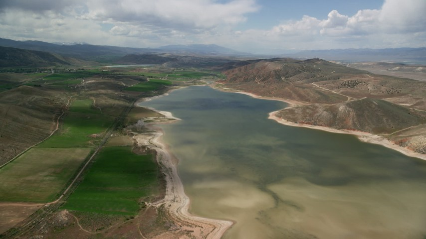 6K stock footage aerial video of flying over Gunnison Reservoir, low water, Sanpete County, Utah Aerial Stock Footage | AX130_152