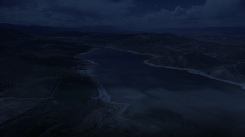 4K day for night color corrected aerial footage of flying over Gunnison Reservoir, low water, Sanpete County, Utah Aerial Stock Footage | AX130_152_DFN