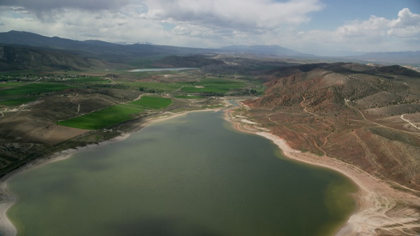 6K stock footage aerial video fly over the Gunnison Reservoir with low water, approach farms, Sterling, Utah Aerial Stock Footage AX130_154 | Axiom Images