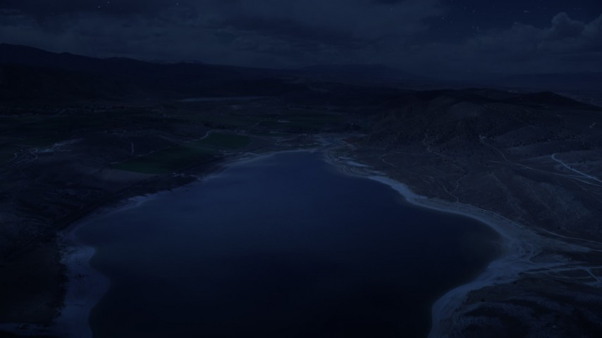 4K day for night color corrected aerial footage fly over the Gunnison Reservoir, low water, approach farms, Sterling, Utah Aerial Stock Footage | AX130_154_DFN