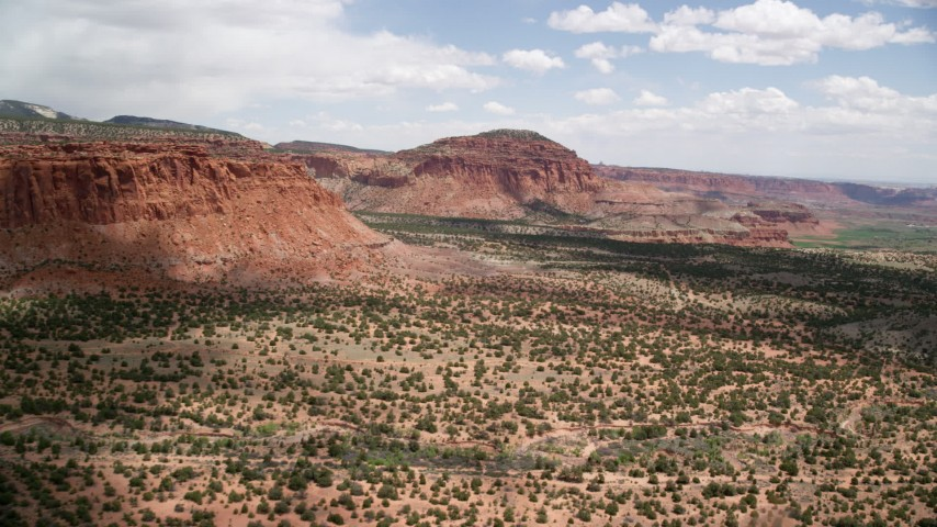 6K stock footage aerial video pan from mesas and approach a butte, Capitol Reef National Park, Utah Aerial Stock Footage | AX130_245