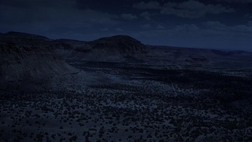 4K day for night color corrected aerial footage of flying by mesas, pan and approach a butte, Capitol Reef National Park, Utah Aerial Stock Footage | AX130_245_DFN