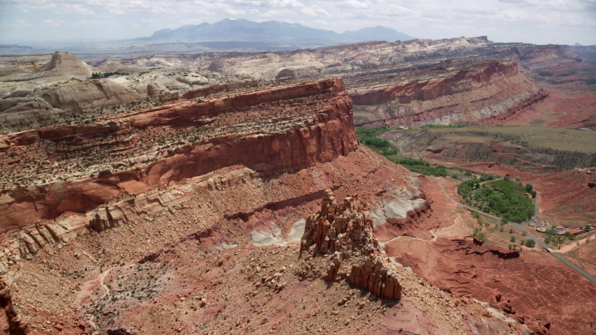 6K stock footage aerial video fly over small butte, approach mesa cliffs near Waterpocket Fold, Capitol Reef National Park, Utah Aerial Stock Footage | AX130_263