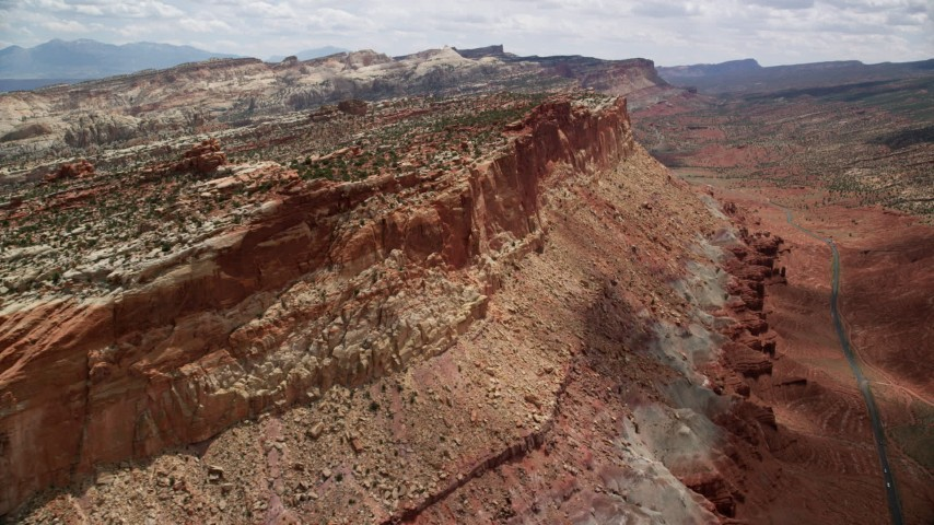 6K stock footage aerial video of approaching side of a mesa, Capitol Reef National Park, Utah Aerial Stock Footage | AX130_268