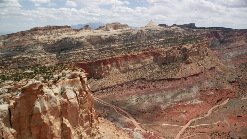 6K stock footage aerial video of approaching Waterpocket Fold rock formations, Capitol Reef National Park, Utah Aerial Stock Footage | AX130_273