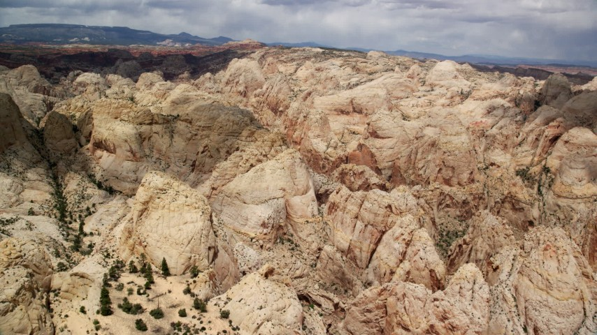 Flying over the Waterpocket Fold rock formations, Capitol Reef National Park, Utah Aerial Stock Footage | AX130_280