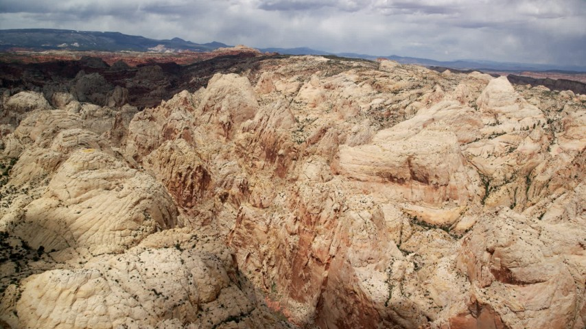 6K stock footage aerial video fly over and pan across Waterpocket Fold rock formations, Capitol Reef National Park, Utah Aerial Stock Footage | AX130_282