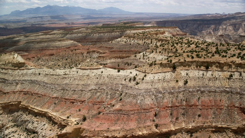Approaching and flying over a mesa, Capitol Reef National Park, Utah Aerial Stock Footage | AX130_290