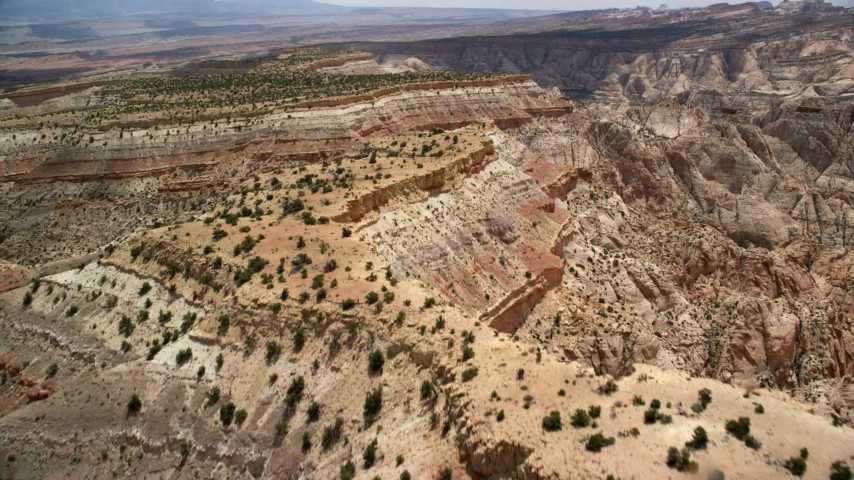 Flying over mesas, Capitol Reef National Park, Utah Aerial Stock Footage | AX130_291
