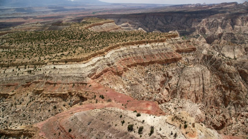 6K stock footage aerial video fly over and approach mesas, Capitol Reef National Park, Utah Aerial Stock Footage | AX130_292
