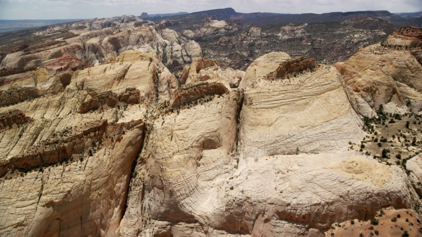 6K stock footage aerial video a flight over the Waterpocket Fold rock formations, Capitol Reef National Park, Utah Aerial Stock Footage | AX130_307