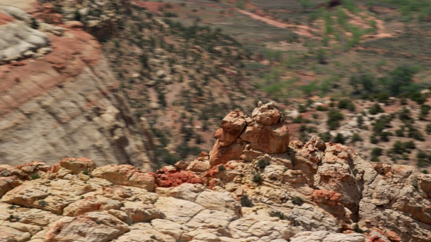 6K stock footage aerial video of orbiting the Waterpocket Fold rock formations, steep canyon, Capitol Reef National Park, Utah Aerial Stock Footage | AX130_312