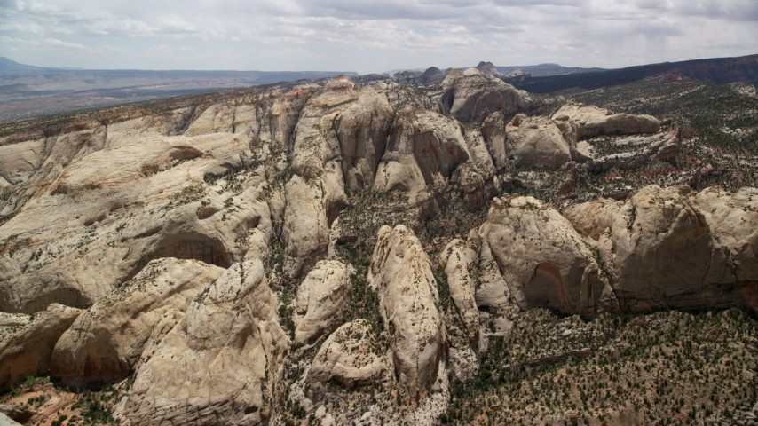 6K stock footage aerial video of flying toward rock formations of Waterpocket Fold, Capitol Reef National Park, Utah Aerial Stock Footage | AX130_313