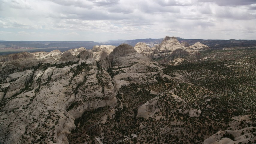 6K stock footage aerial video approach and fly over Waterpocket Fold rock formations, Capitol Reef National Park, Utah Aerial Stock Footage | AX130_319