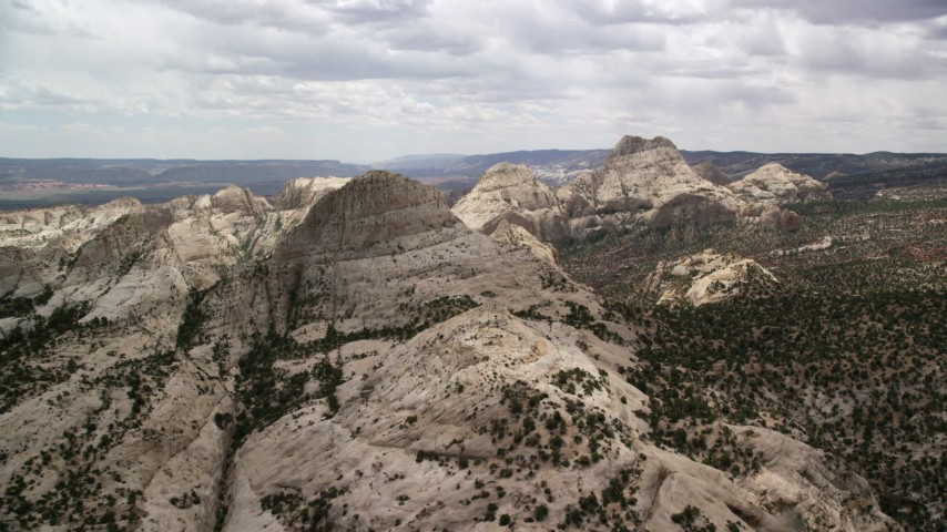 6K stock footage aerial video of flying toward and over Waterpocket Fold rock formations, Capitol Reef National Park, Utah Aerial Stock Footage | AX130_320