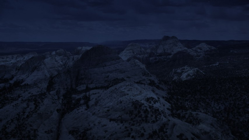 4K day for night color corrected aerial footage of approaching Waterpocket Fold rock formations, Capitol Reef National Park, Utah Aerial Stock Footage | AX130_320_DFN