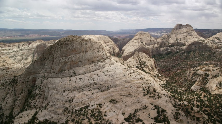 6K stock footage aerial video approach and pan to a Waterpocket Fold rock formation, Capitol Reef National Park, Utah Aerial Stock Footage | AX130_321