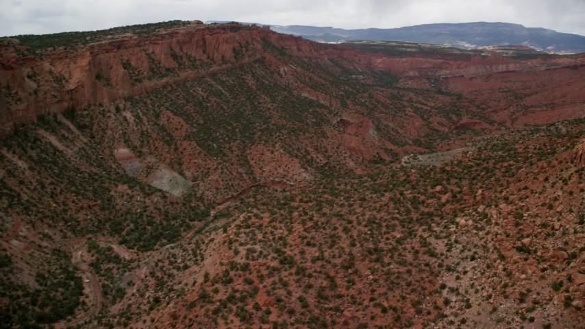 6K stock footage aerial video of flying over a desert canyon, desert vegetation, Capitol Reef National Park, Utah Aerial Stock Footage | AX130_330
