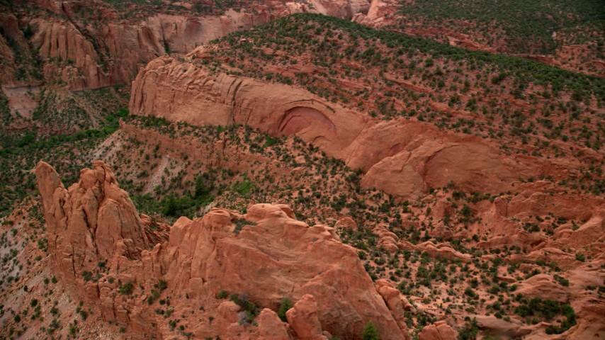 Flying by a butte, near mesas, Capitol Reef National Park, Utah Aerial Stock Footage | AX130_335