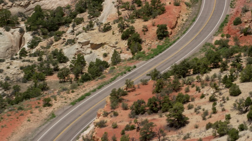 6K stock footage aerial video of following a black SUV traveling Route 12, Boulder, Utah Aerial Stock Footage | AX130_377
