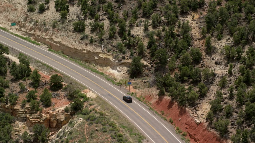 6K stock footage aerial video of tracking a black SUV, Route 12, revealing silver sedan, Boulder, Utah Aerial Stock Footage | AX130_381