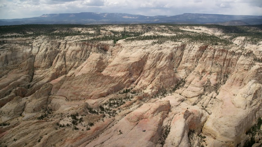 Approaching, flying over a canyon, Grand Staircase-Escalante National Monument, Utah Aerial Stock Footage | AX130_384