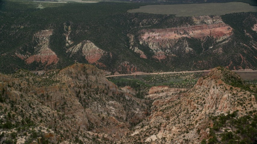 Approaching a canyon, Hells Backbone Road, Grand Staircase-Escalante National Monument, Utah Aerial Stock Footage | AX130_390