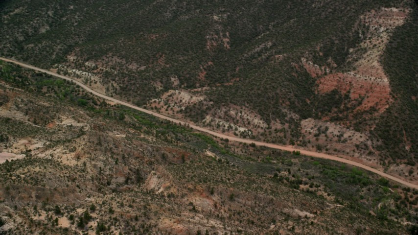 Flying by Hells Backbone Road, tilt up, Grand Staircase-Escalante National Monument, Utah Aerial Stock Footage | AX130_391