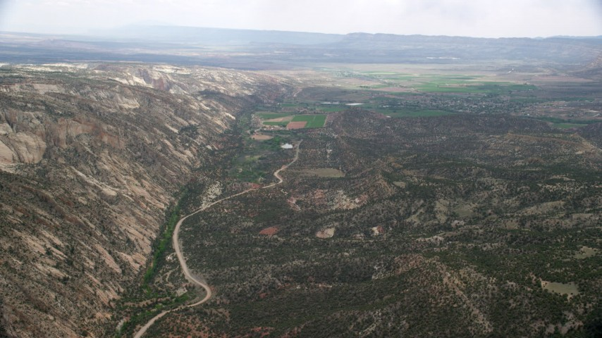 Flying by Hells Backbone Road leading to Escalante, Grand Staircase-Escalante National Monument, Utah Aerial Stock Footage | AX130_393
