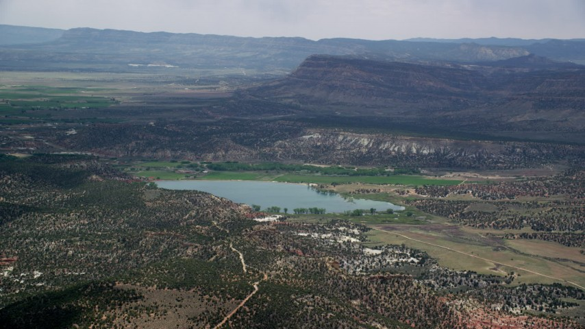 6K stock footage aerial video of flying by a reservoir, Grand Staircase-Escalante National Monument, Utah Aerial Stock Footage | AX130_397
