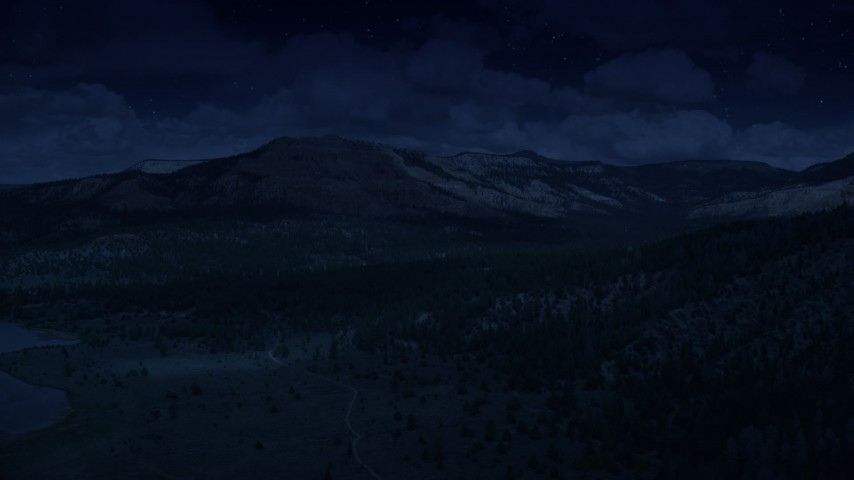 4K day for night color corrected aerial footage of flying by mesa, desert vegetation and trees in the foreground, revealing Pine Lake; Barney Top Mesa, Utah Aerial Stock Footage | AX130_414_DFN
