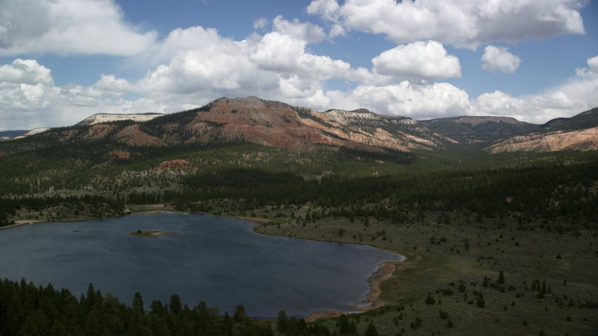 Flying by Barney Top Mesa, seen from Pine Lake, Barney Top Mesa, Utah Aerial Stock Footage | AX130_415