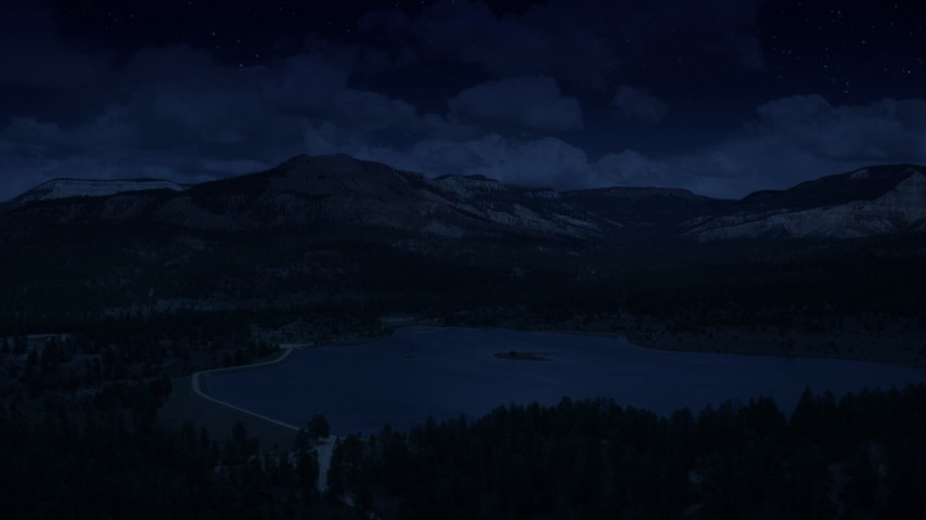 6K day for night color corrected aerial footage of flying by Barney Top Mesa, seen from Pine Lake, Utah Aerial Stock Footage | AX130_416_DFN