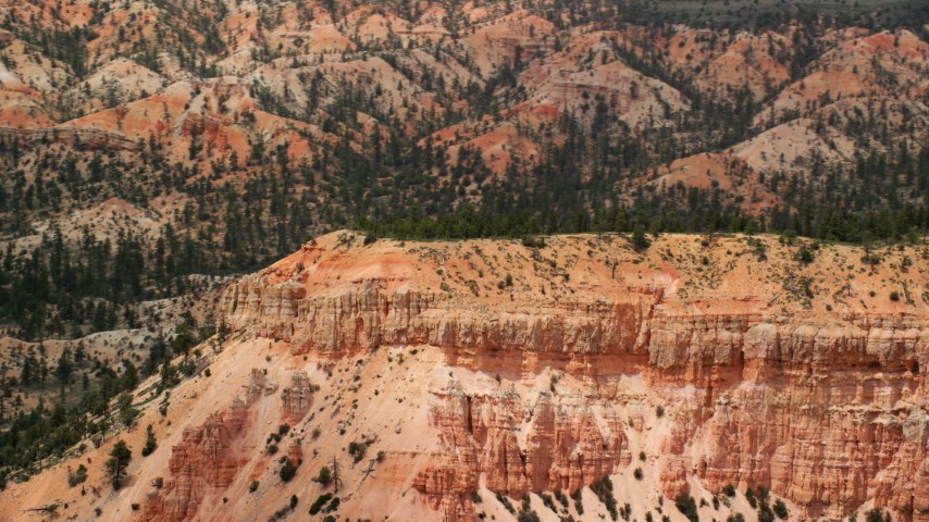 Flying by end of a thin mesa, steep slopes, Bryce Canyon National Park, Utah Aerial Stock Footage | AX130_428