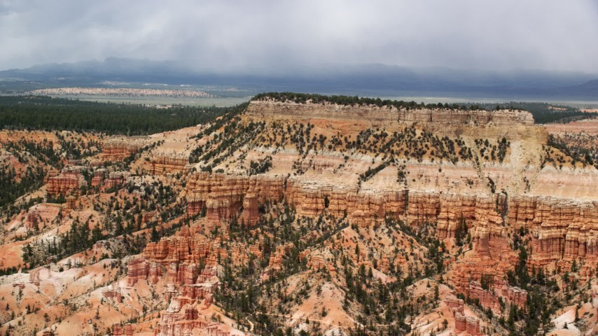 Flying by groups of hoodoos, mesa, Bryce Canyon National Park, Utah Aerial Stock Footage | AX130_430