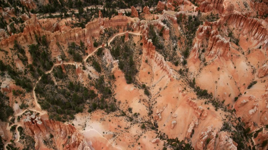 6K stock footage aerial video bird's eye view of hoodoos, buttes, dirt roads, dry riverbed, Bryce Canyon National Park, Utah Aerial Stock Footage | AX130_434