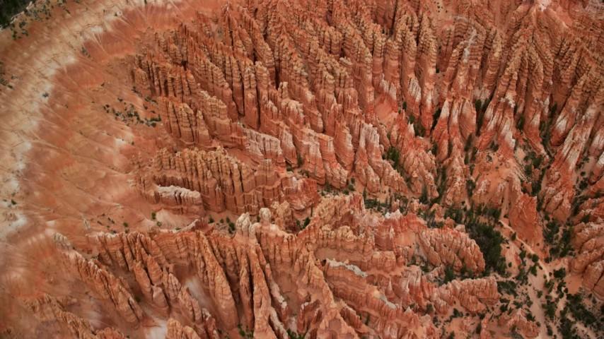 Bird's eye view orbiting large group of hoodoos, Bryce Canyon National Park, Utah Aerial Stock Footage | AX130_436