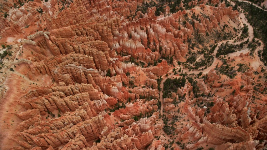 Bird's eye view orbiting large group of hoodoos, Bryce Canyon National Park, Utah Aerial Stock Footage | AX130_437