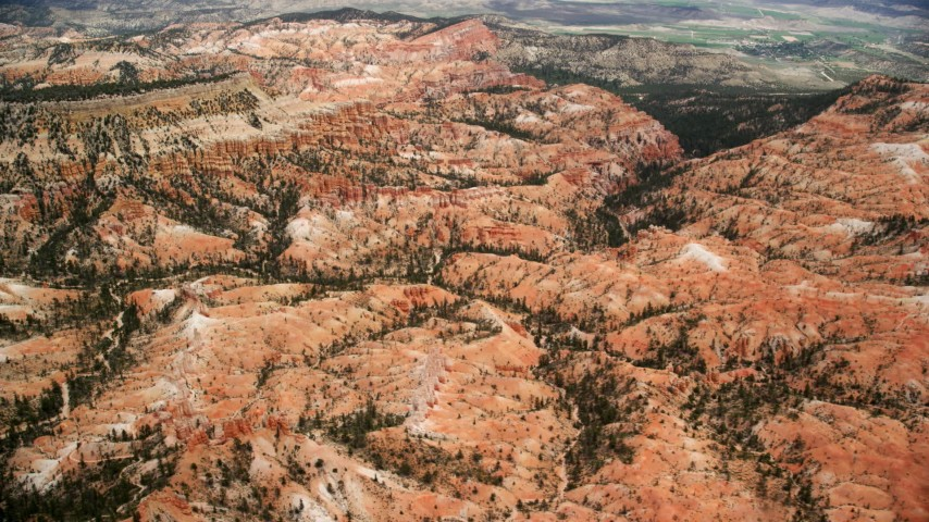 6K stock footage aerial video of passing by hills, mesa, hoodoos at Bryce Canyon National Park, Utah Aerial Stock Footage AX130_439